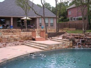 Backyard with rock and stone retaining walls