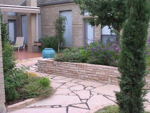 Broken stone pattern in backyard with vase water feature
