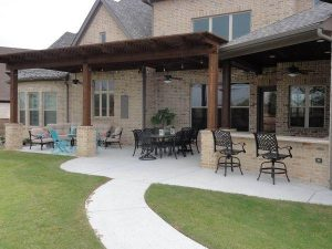 Back porch with kitchen and wooden pergola