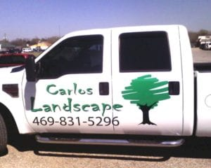 White work truck with vinyl decals for landscape company