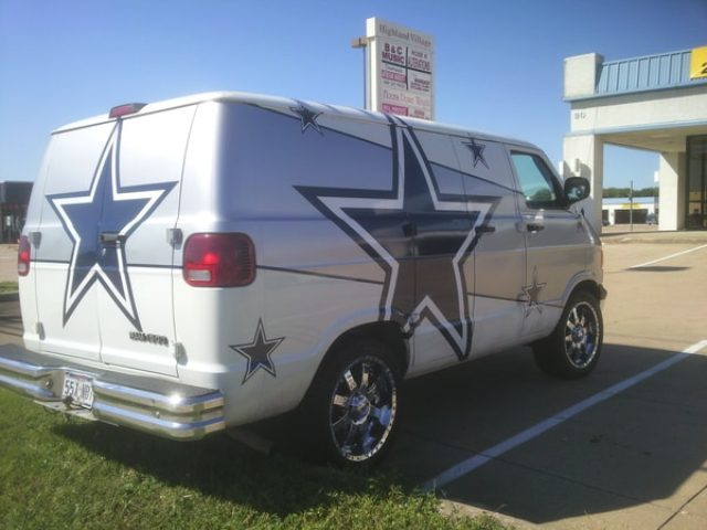 White and silver van with Dallas Cowboys logos