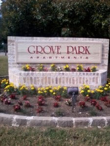 Wood and bridge sign for an apartment complex
