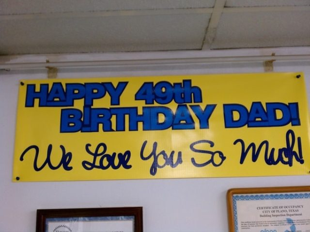 Yellow banner with blue lettering that says Happy 49th Birthday Day