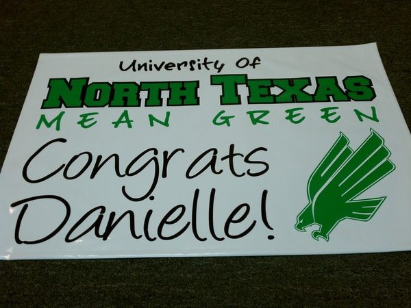 White banner with UNT logo that says Congrats Danielle