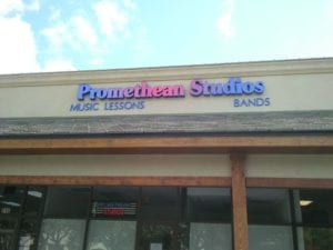 Storefront sign for Promethean Studios