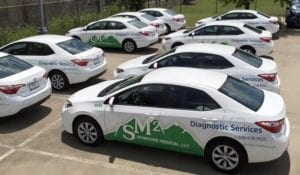 Fleet of cars with vinyl car wrap decals for diagnostic service company