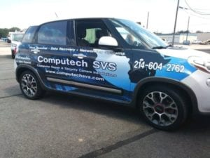 Hatchback car with vinyl decal car wrap for computer company