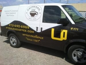 Black and white van with vinyl decals for espresso coffee company