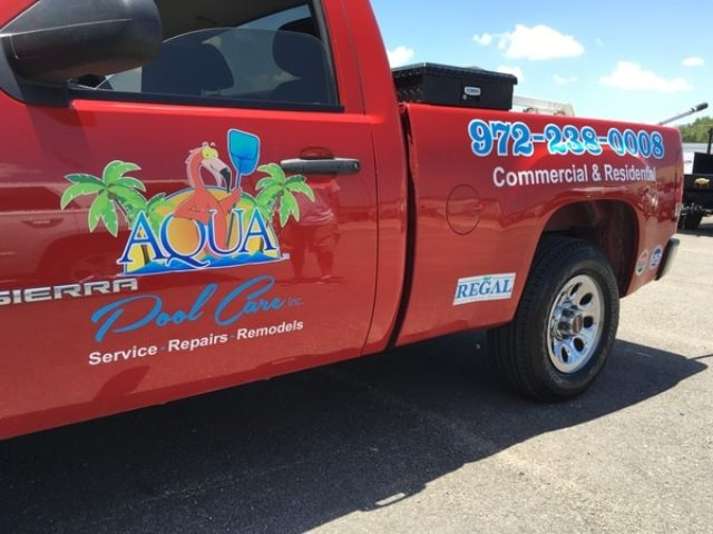 Red work truck with vinyl decals for pool repair company