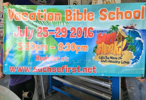 Colorful banner advertising Vacation Bible School for a church