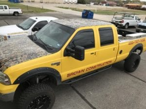 Yellow F250 work truck with red vinyl decal lettering for Brown Construction