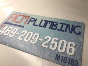 Blue car magnet for a plumbing company