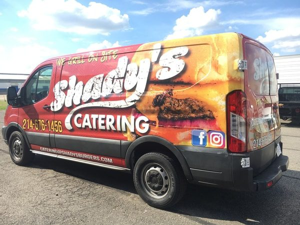 Work truck with vinyl wrap for catering restaurant