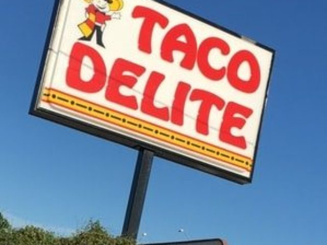 Large billboard sign for taco restaurant