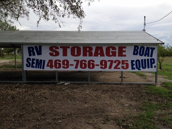 Awning with large banner hanging advertising Boat and RV storage