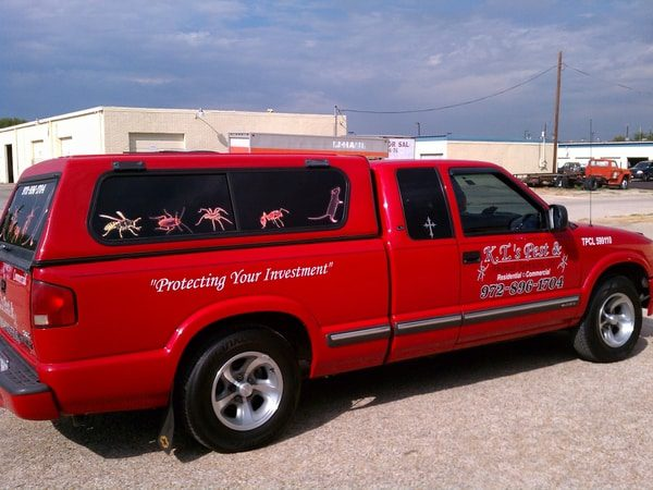 Red truck with decals for a pest control company