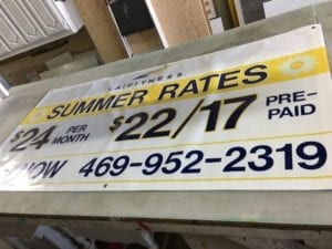 Large banner advertising LA Fitness's summer rates
