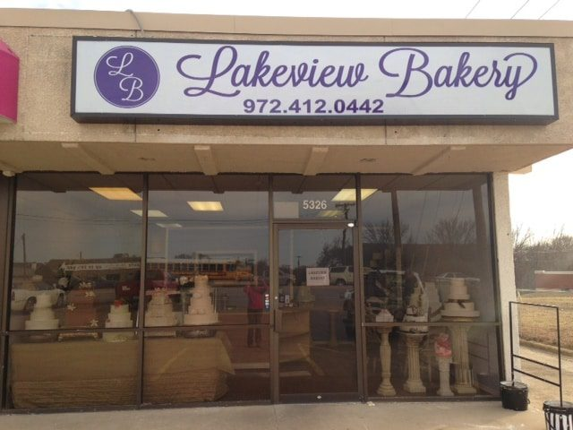Purple storefront sign for Lakeview Bakery