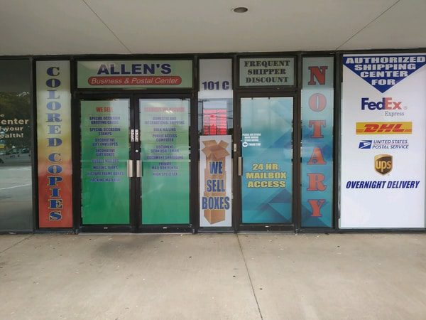 Multiple colorful vinyl window decals for postal center business