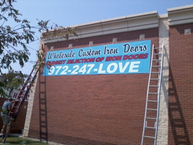 Blue banner for custom iron door company