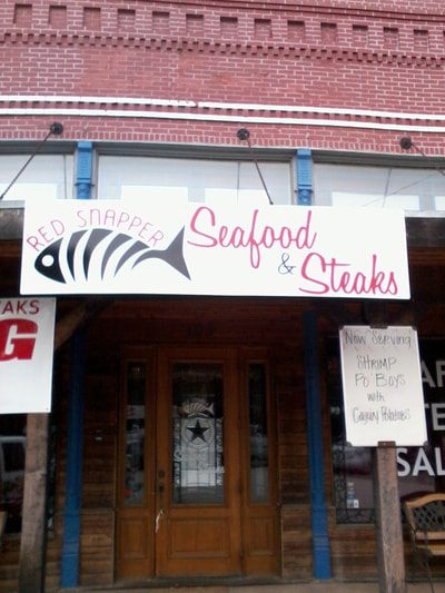 White banner for seafood and steak restaurant