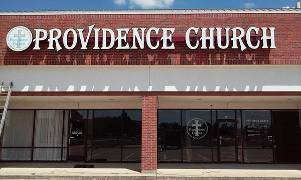 White storefront sign for Providence Church