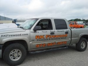 Grey truck with vinyl decals for a firewood and smoking wood company