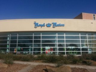 Blue storefront sign for Royal Nation
