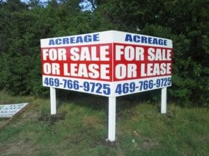 Two-sided billboard for land acreage
