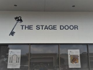 Storefront sign for The Stage Door