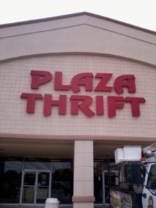 Storefront sign for Plaza Thrift