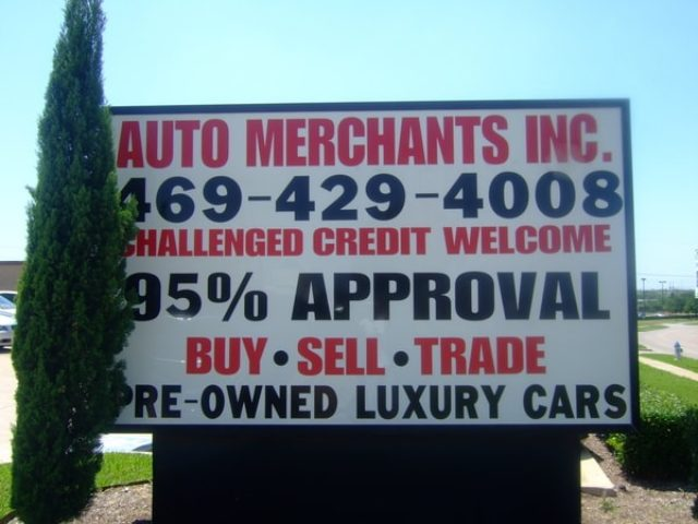 Billboard sign for auto merchant company