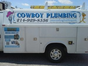 White work truck with vinyl decals for Cowboy Plumbing company