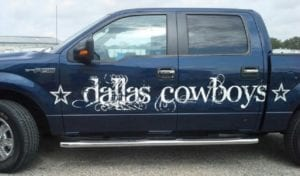 Blue Ford F150 with Dallas Cowboys decals