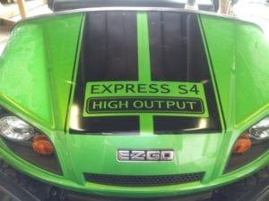 Green golf cart with black vinyl decals