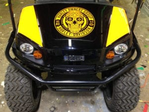 Black and yellow UTV with yellow Harley-Davidson skull decal
