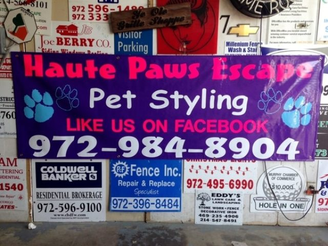 Wall full of banners ranging from brokerage firms, to fence companies, to pet styling companies