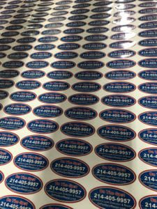Rows of red, white, and blue oval stickers