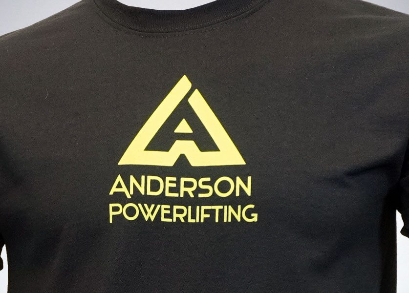 close up of anderson powerlifting new logo t-shirt