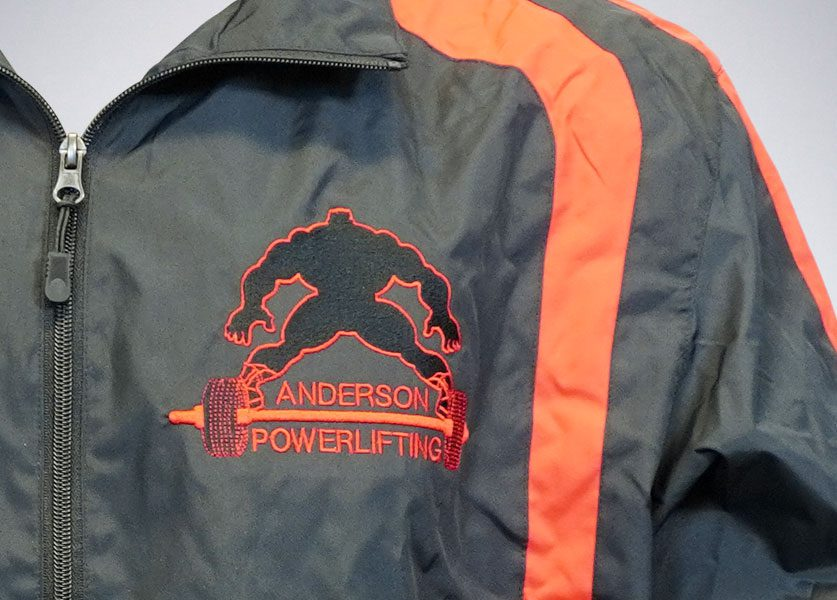 close up of anderson powerlifting black and red jacket