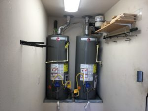 two hot water heaters beside each other