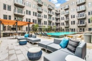 beautiful apartment pool in courtyard with seating