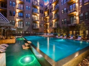night time photo of a apartment building and pool