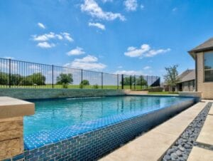 negative edge pool with blue glass tiles