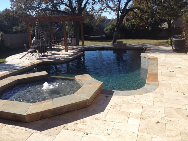 a pool, gazebo, and water feature