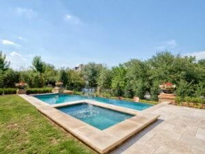 wide shot of a pool with a water feature