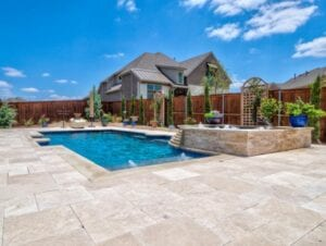 concrete patio with pool in background