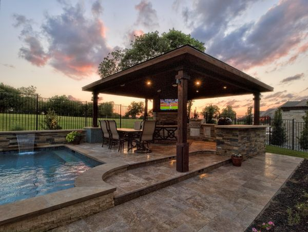 wide shot of a pool and outdoor kitchen