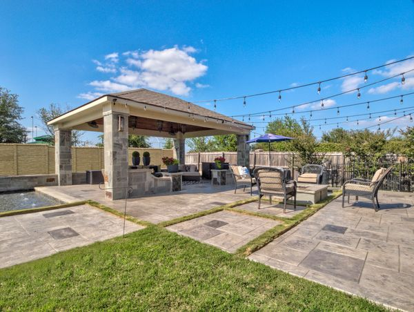 wide shot of a covered outdoor kitchen