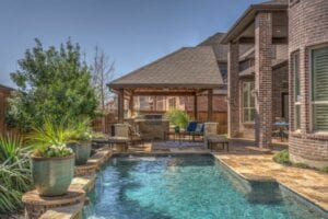 close up of a pool and outdoor kitchen